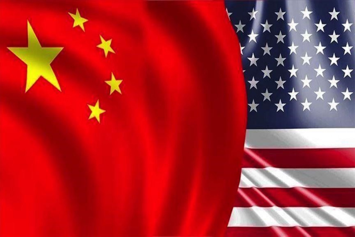 US threatens to ban Chinese firms